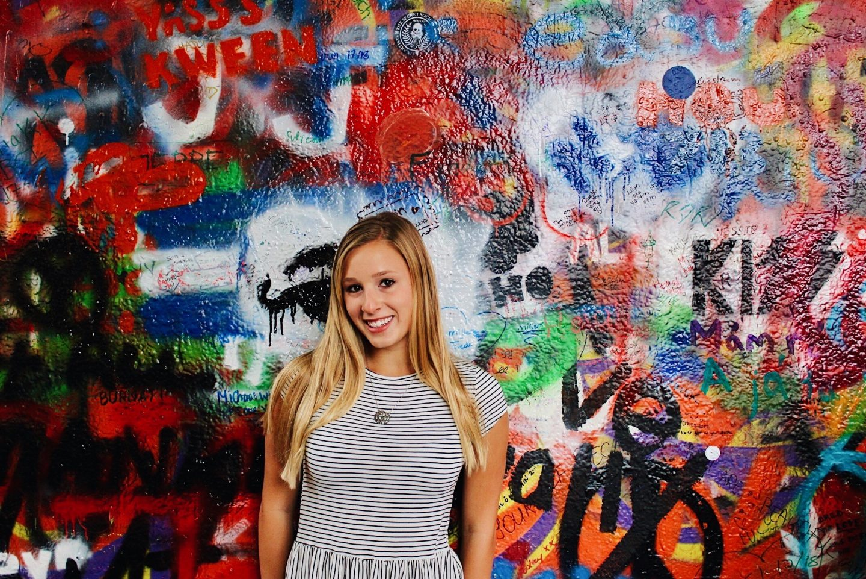 Posing in front of the John Lennon Wall in Prague