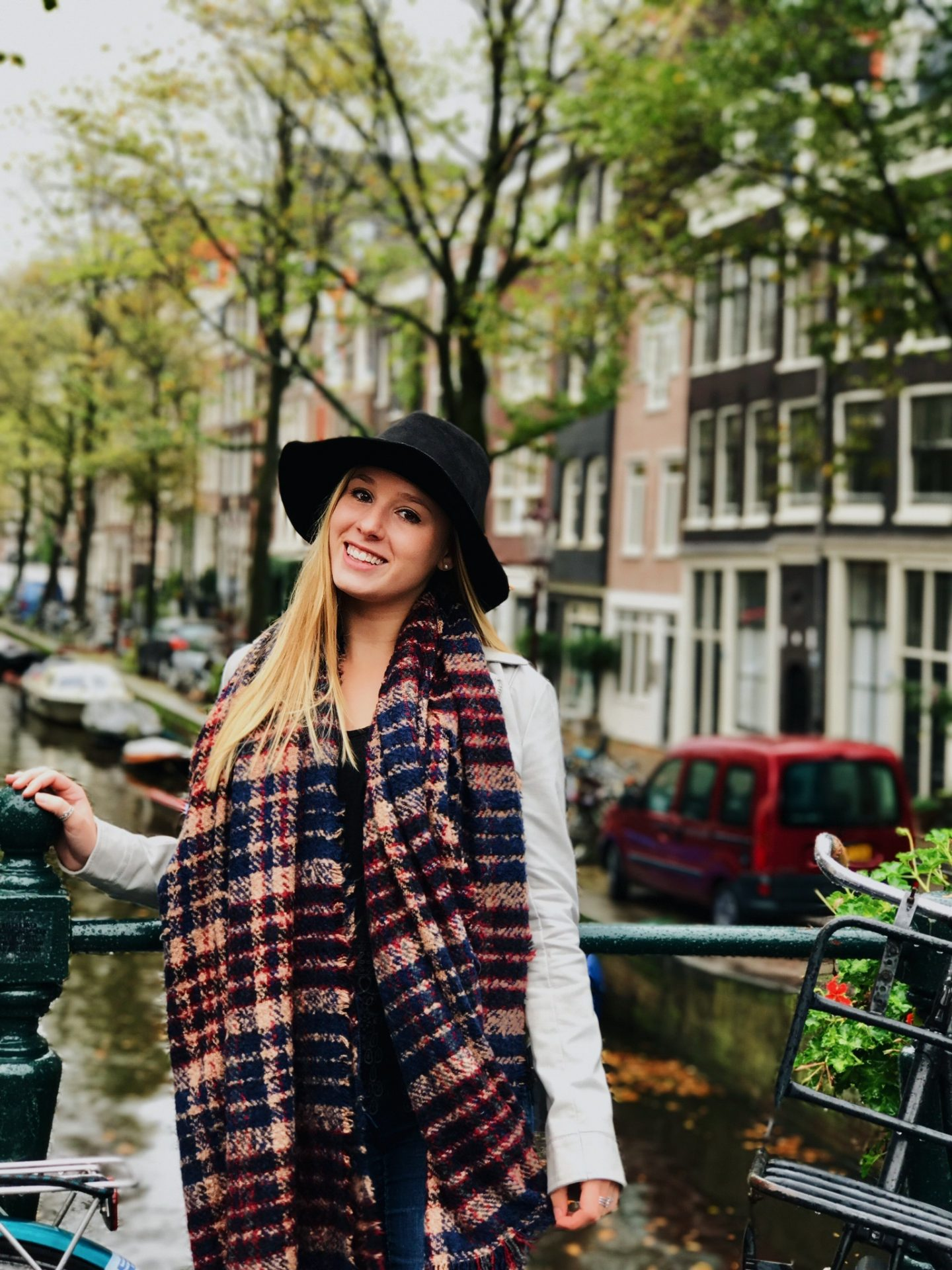 Posing in front of the colorful row houses and canals of Amsterdam