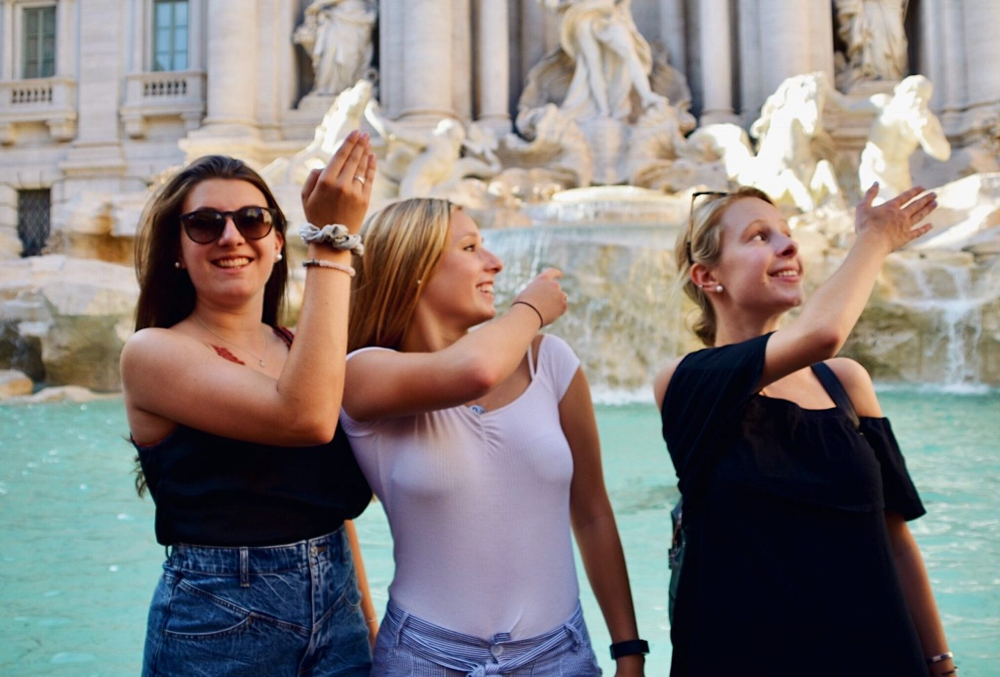 Throwing a coin into the Trevi Fountain in Rome, Italy
