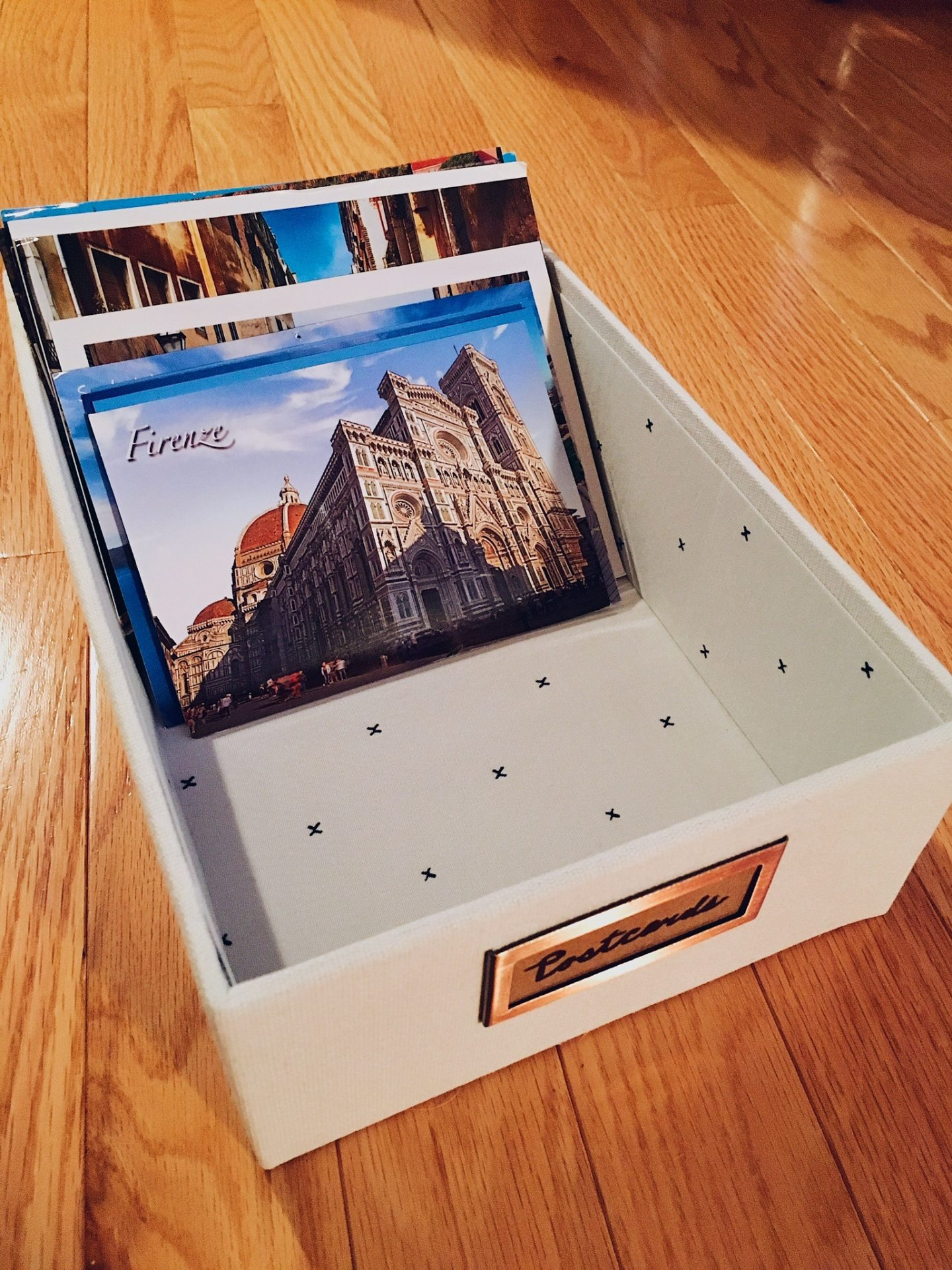 My postcard collection in a box in my room
