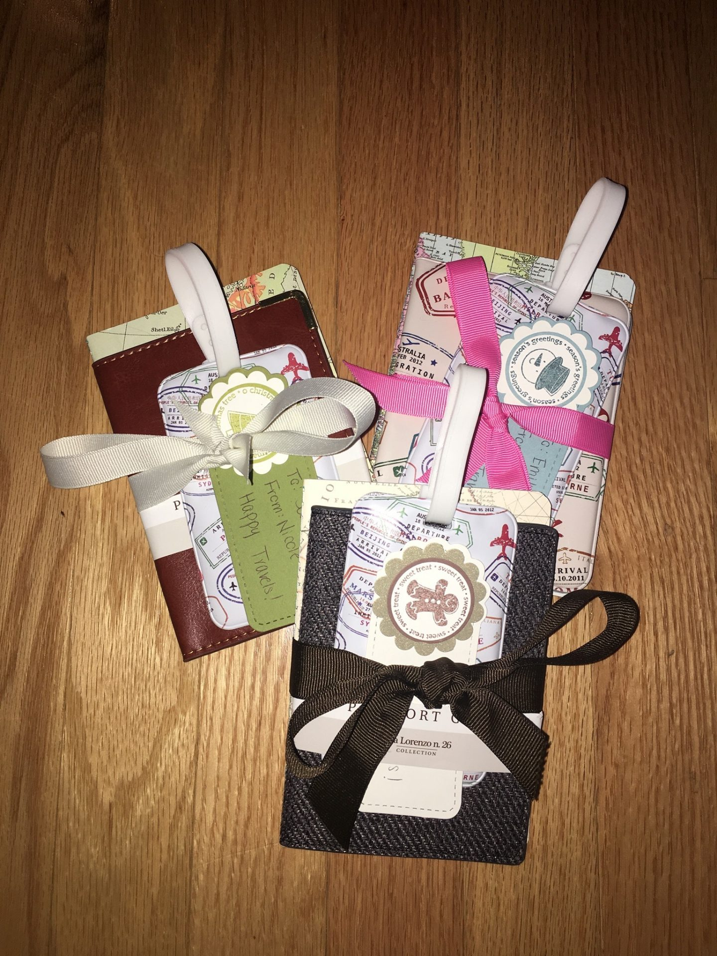 A passport cover, travel journal, and luggage tag gifts for travel lovers