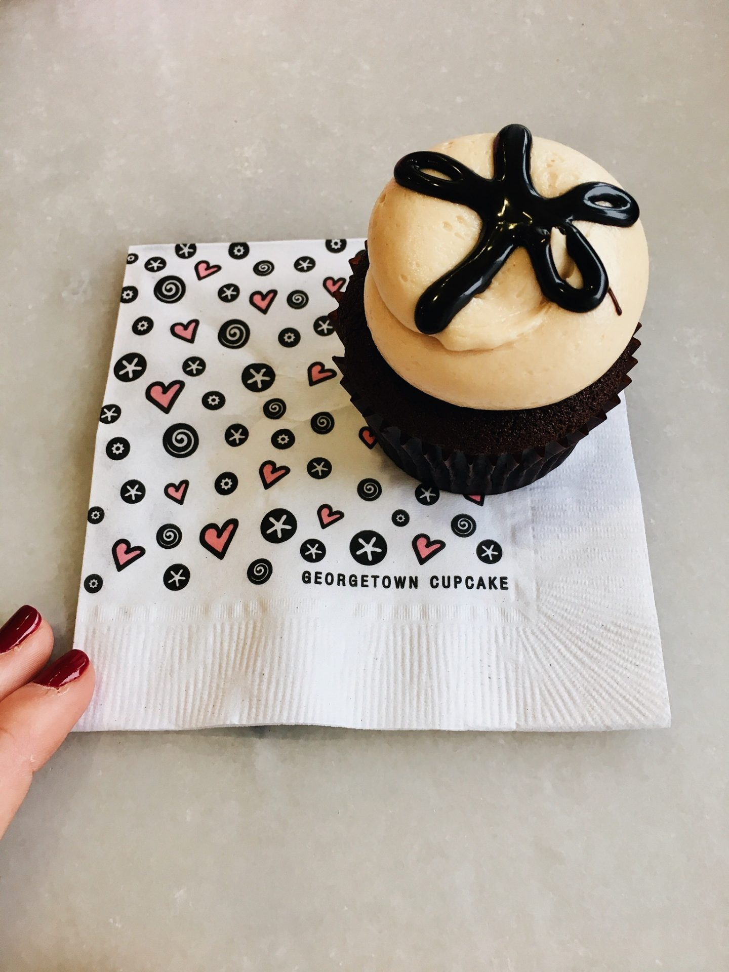Eating a cupcake at DC Cupcakes in Georgetown in Washington DC