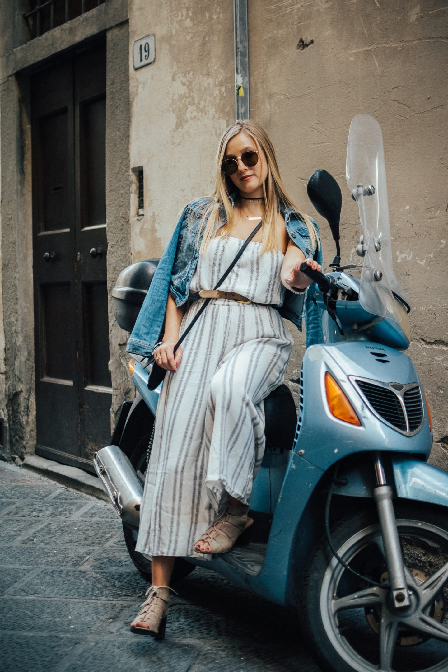 Posing on a vespa during my semester abroad in Florence, Italy.