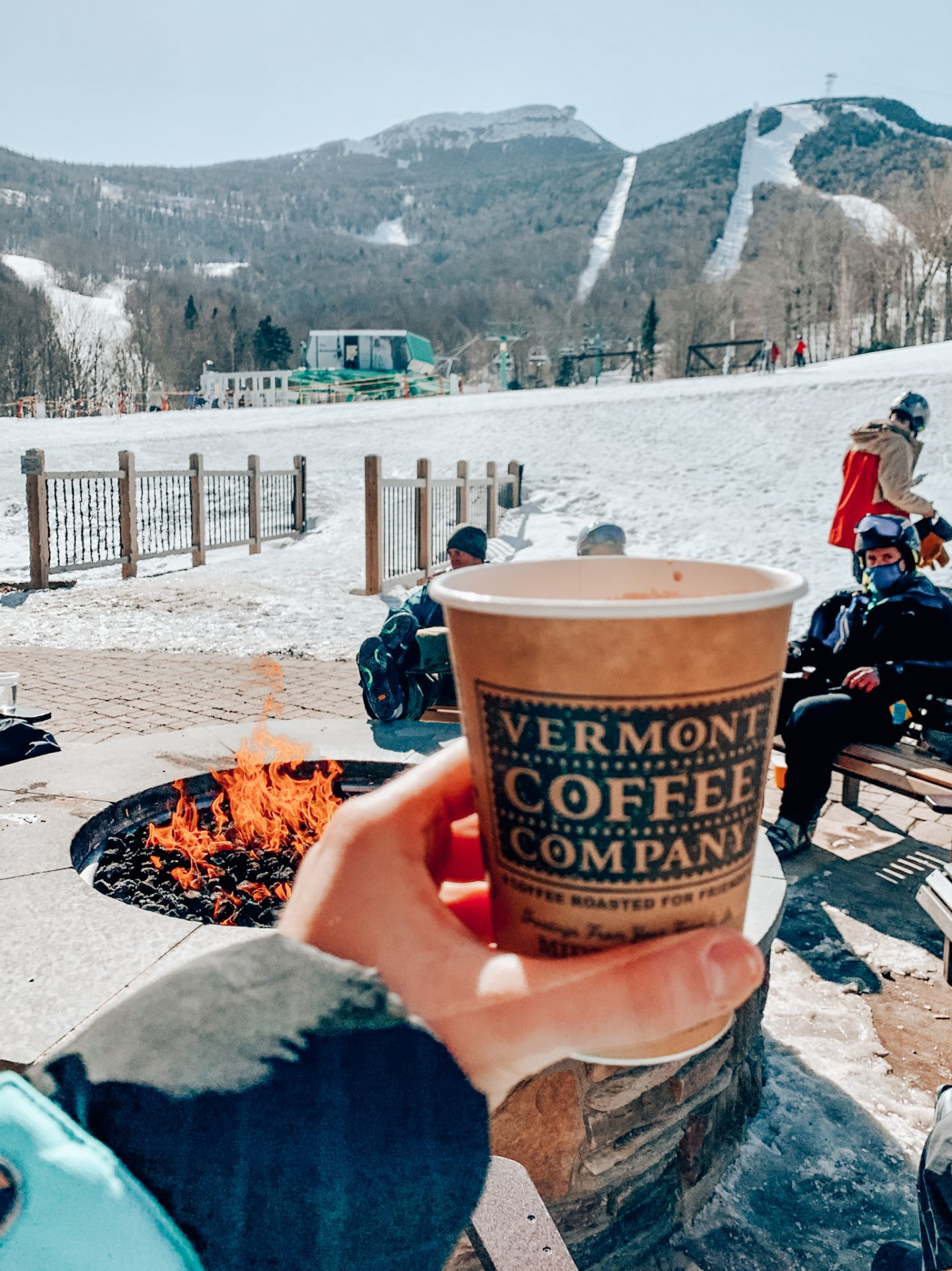 Hot cocoa in front of fire at Jay Peak Resort