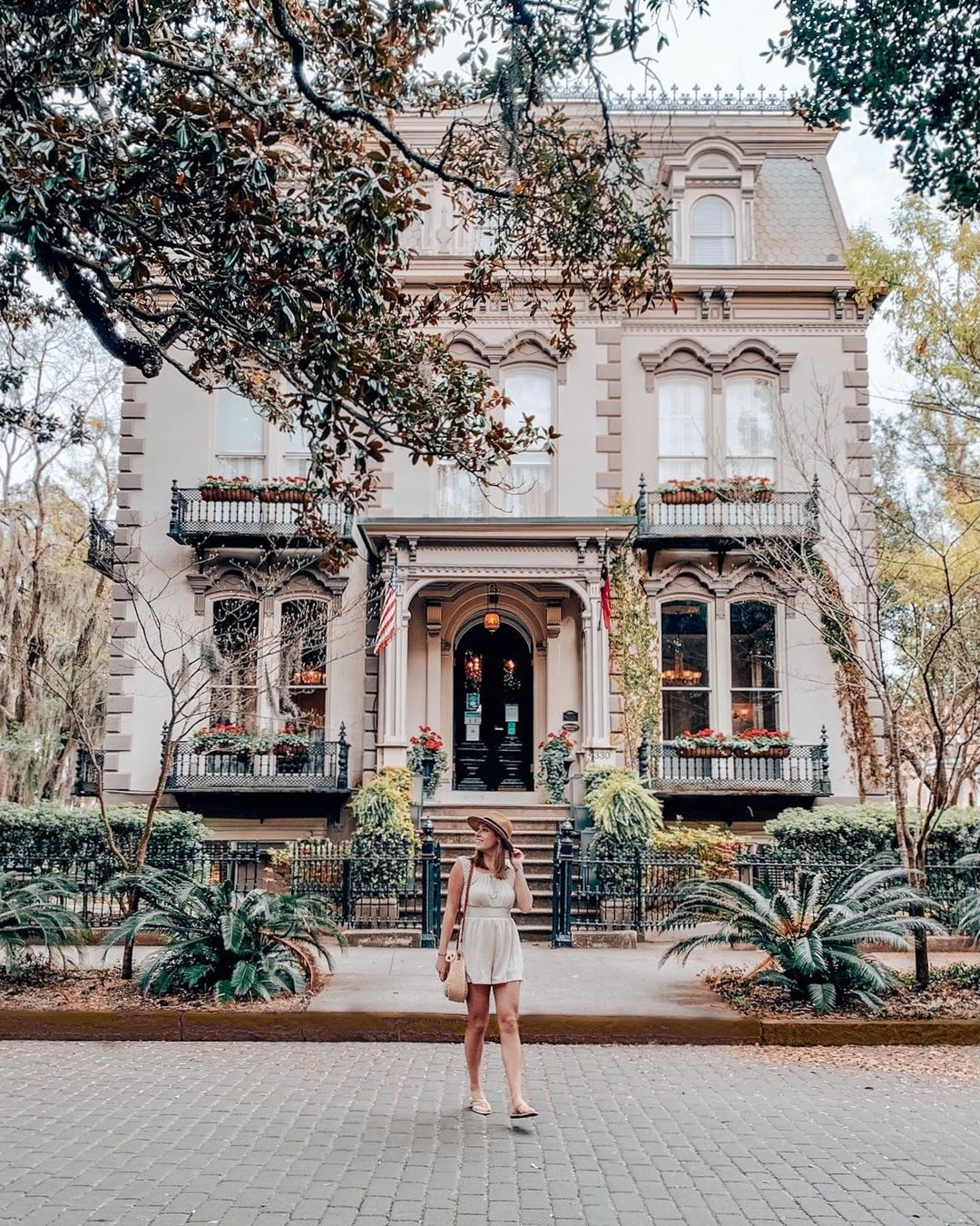 Girl poses in front of the Hamilton Turner Inn