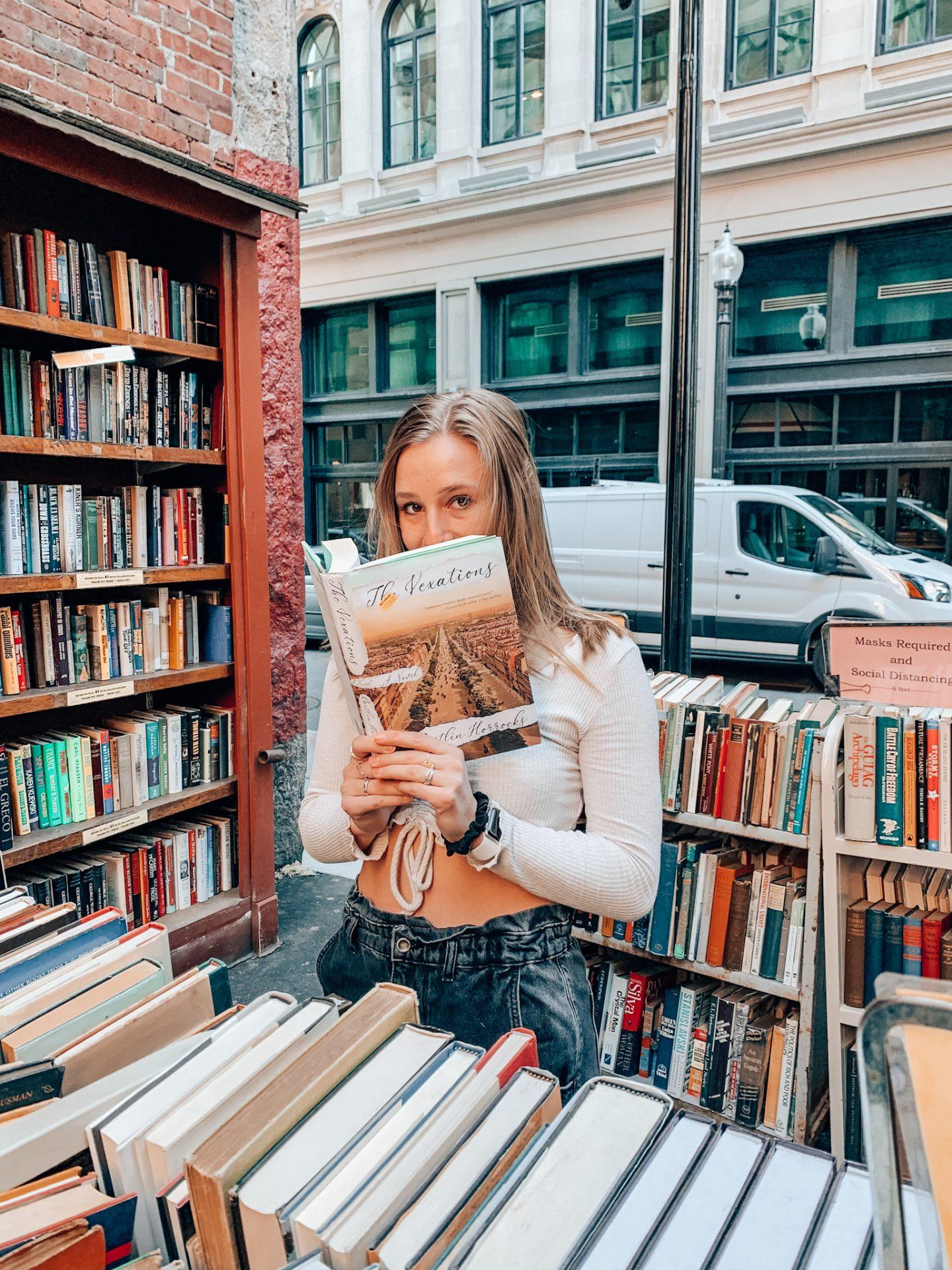 Posing in the stacks of Brattle Bookshop in Boston